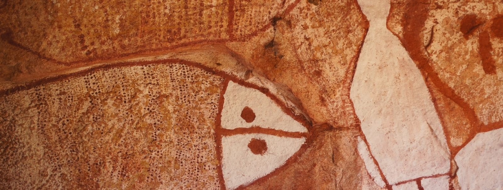 Aboriginal cave paintings of fish in red and white ochre from Ancient Australia